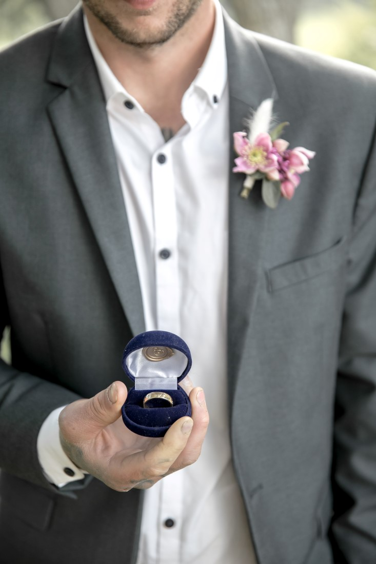 Purple Lilac Spring Wedding Hattie Root Photo groom holding ring