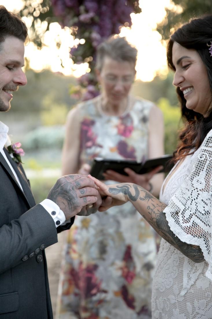 Purple Lilac Spring Wedding Hattie Root Photo Exchanging rings