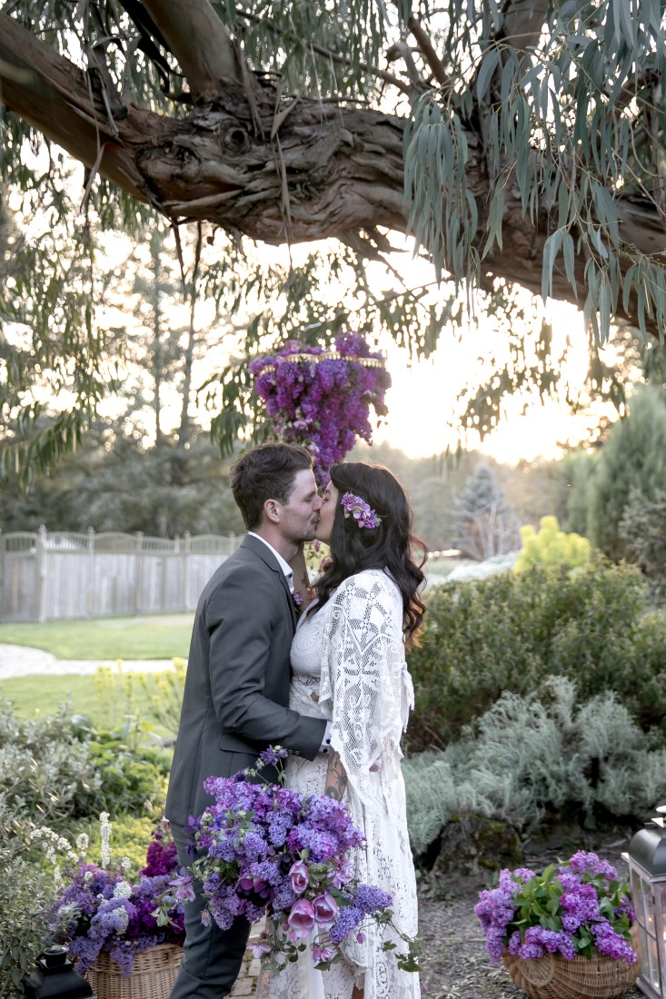 Purple Lilac Spring Wedding Hattie Root Photography bride and groom kissing