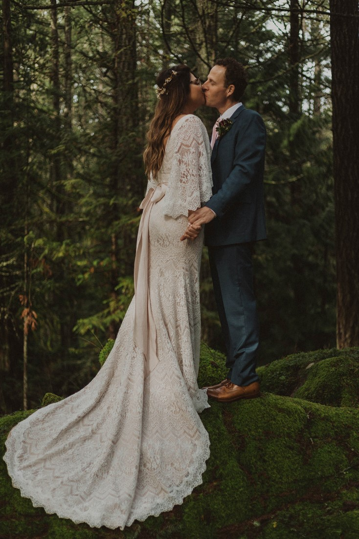 Sophisticated Gallery Kacie McColm Photography kisses in the forest