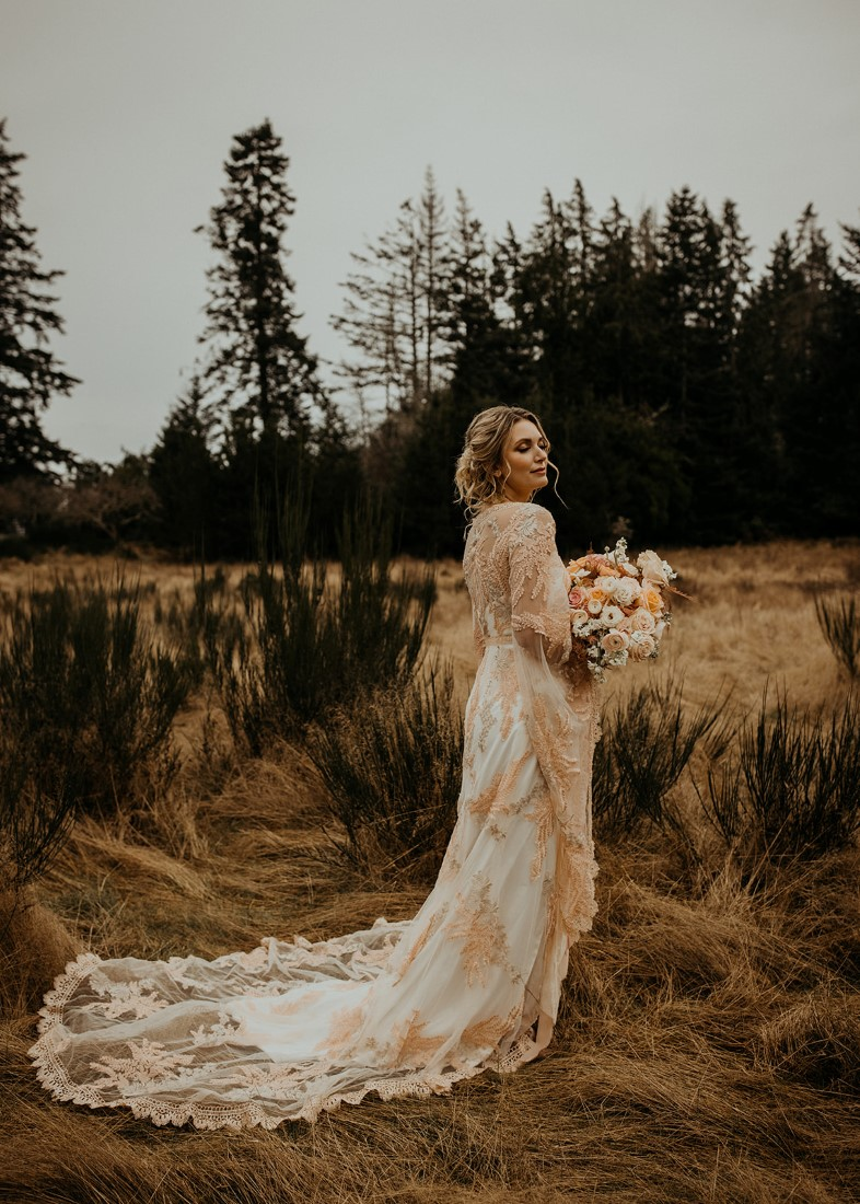 Romantic Cover for Vancouver Island Magazine Secret Waters Photography bride poses with side view of gown