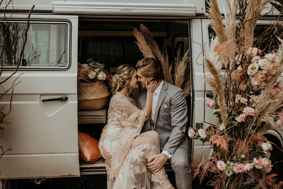 Romantic Cover for Vancouver Island Magazine Secret Waters Photography newlyweds kiss in Volkswagen van