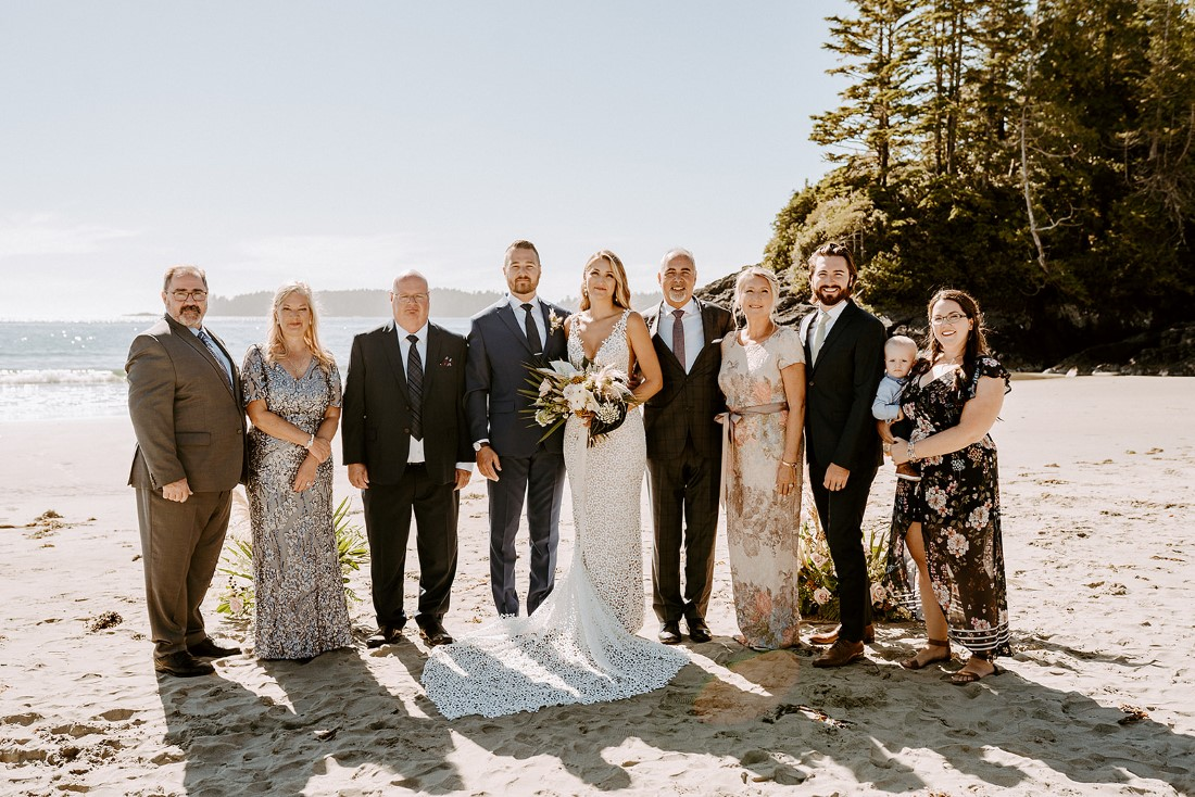 Guests at elopement on Tofino beach by Wild and Wed Photography
