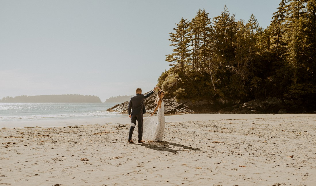 Beach Wed in Tofino couple walk towards the ocean together