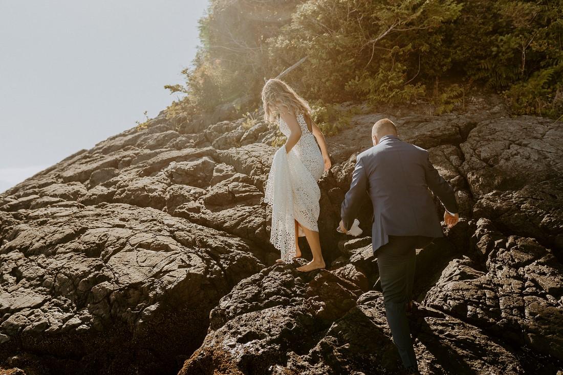 Beach Wed in Tofino couple climb rocks