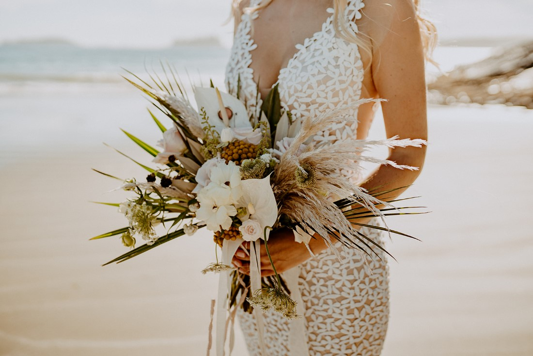 Brides bouquet of pampas grass and white roses by Crab Apple Floral Tofino