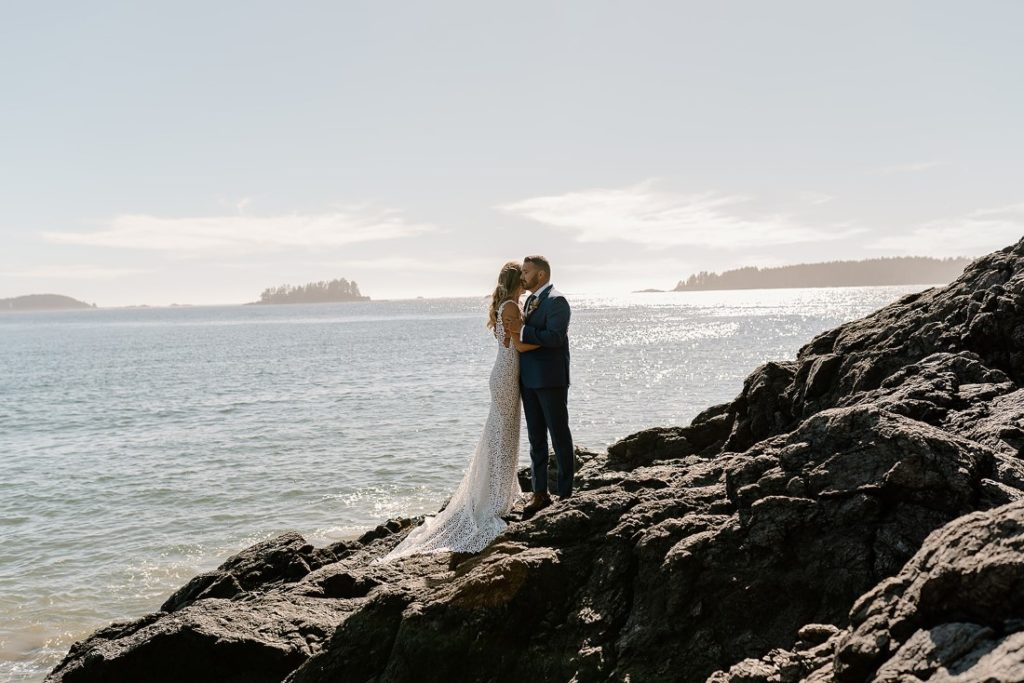 Beach Wed in Tofino newlyweds with ocean behind them