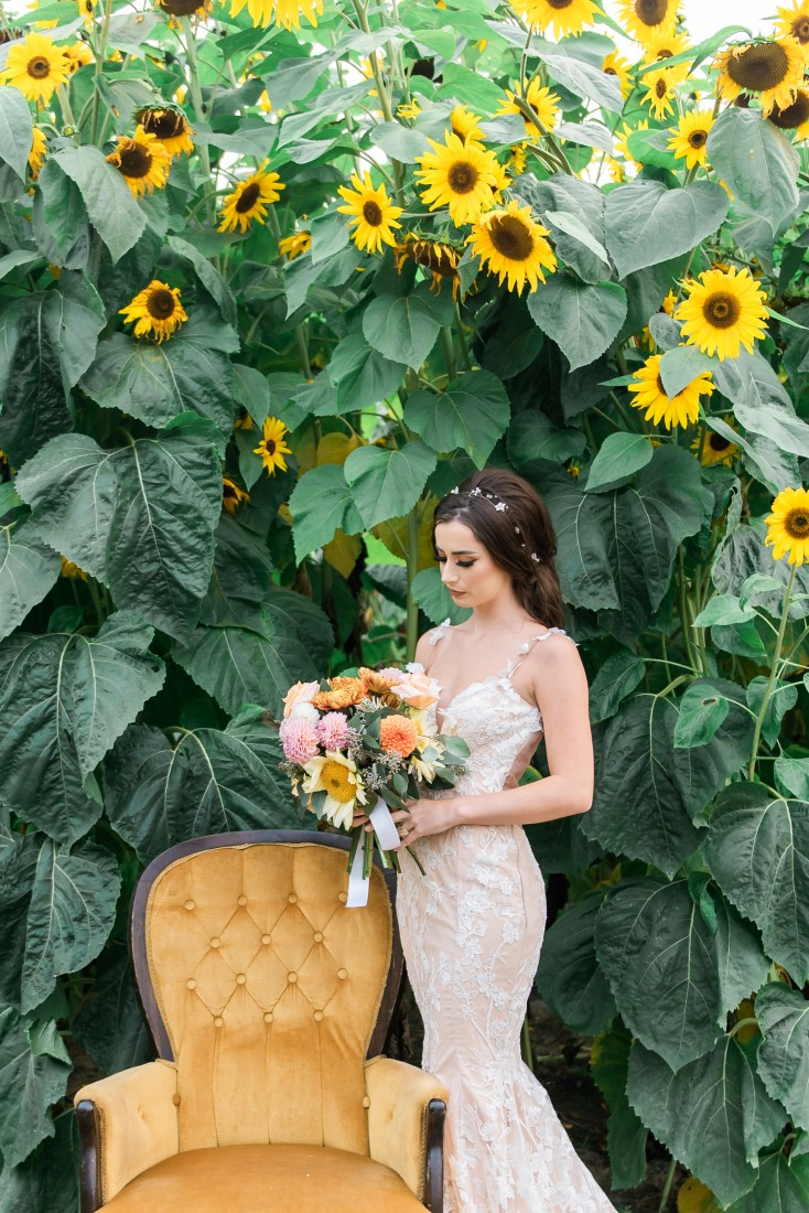 Sunflowers and Sunshine Wedding Inspo bride and gold chair