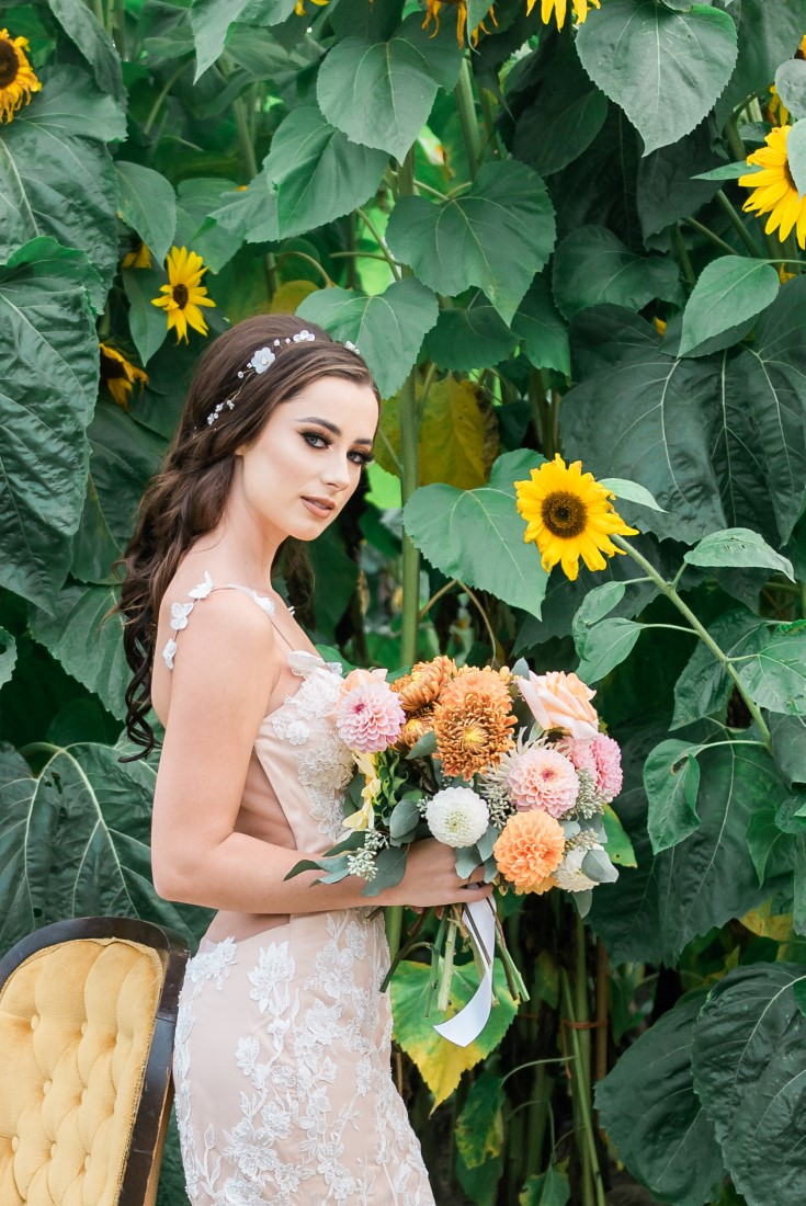 Sunflowers and Sunshine Wedding Inspo bride and her bouquet
