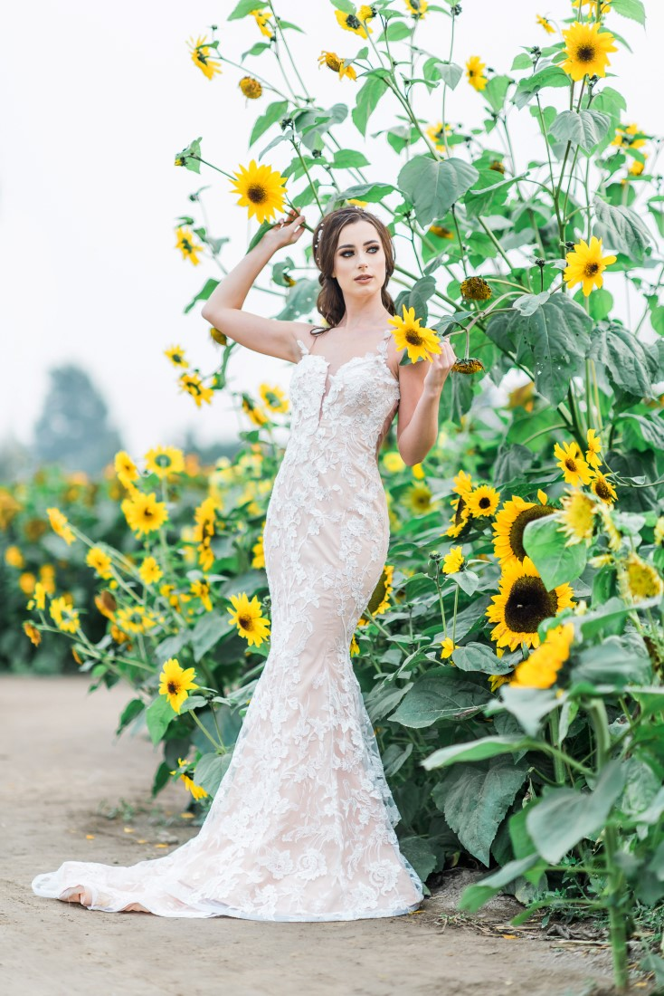 Sunflowers and Sunshine Wedding Inspo bride in sunflower patch