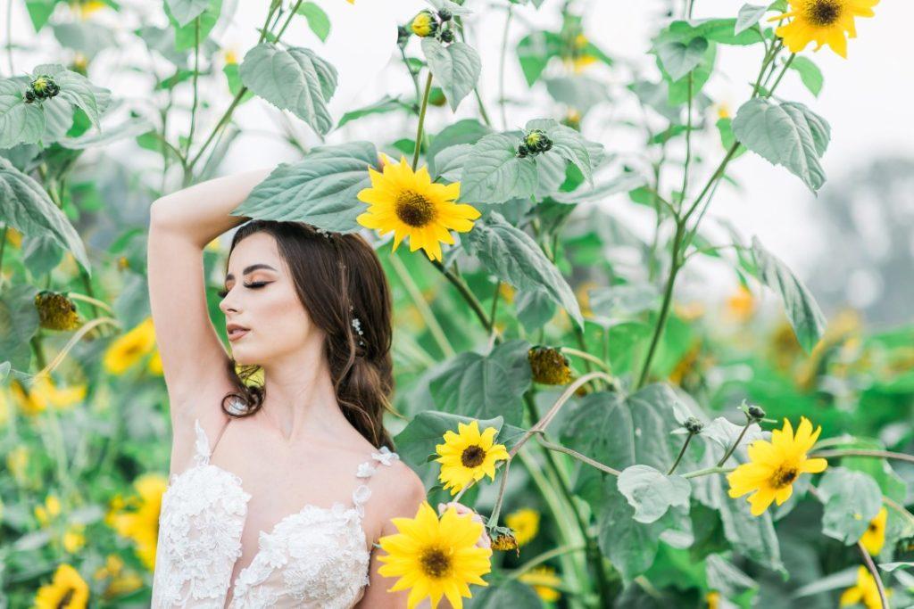 Sunflowers and Sunshine Wedding Inspo bride amongst sunflowers