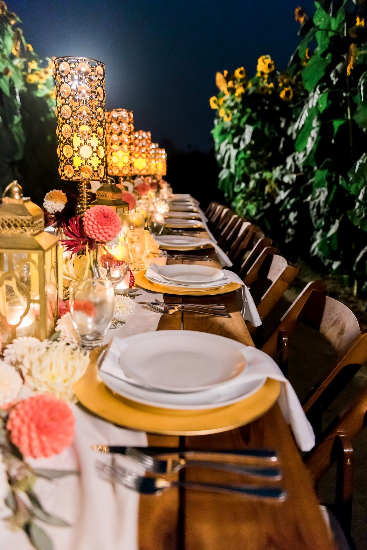 Sunflowers and Sunshine Wedding Inspo yellow chargers and funky lamps tablescape