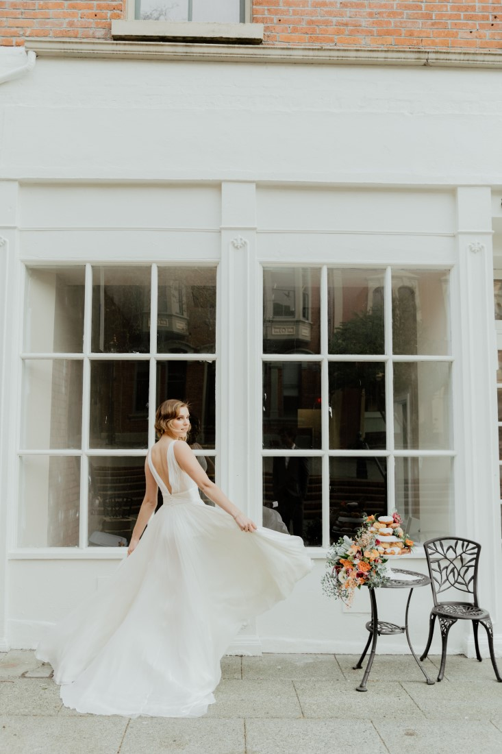 Coffee Love in Comox Valley Luke Liable Photography Bride twirling in front of cafe