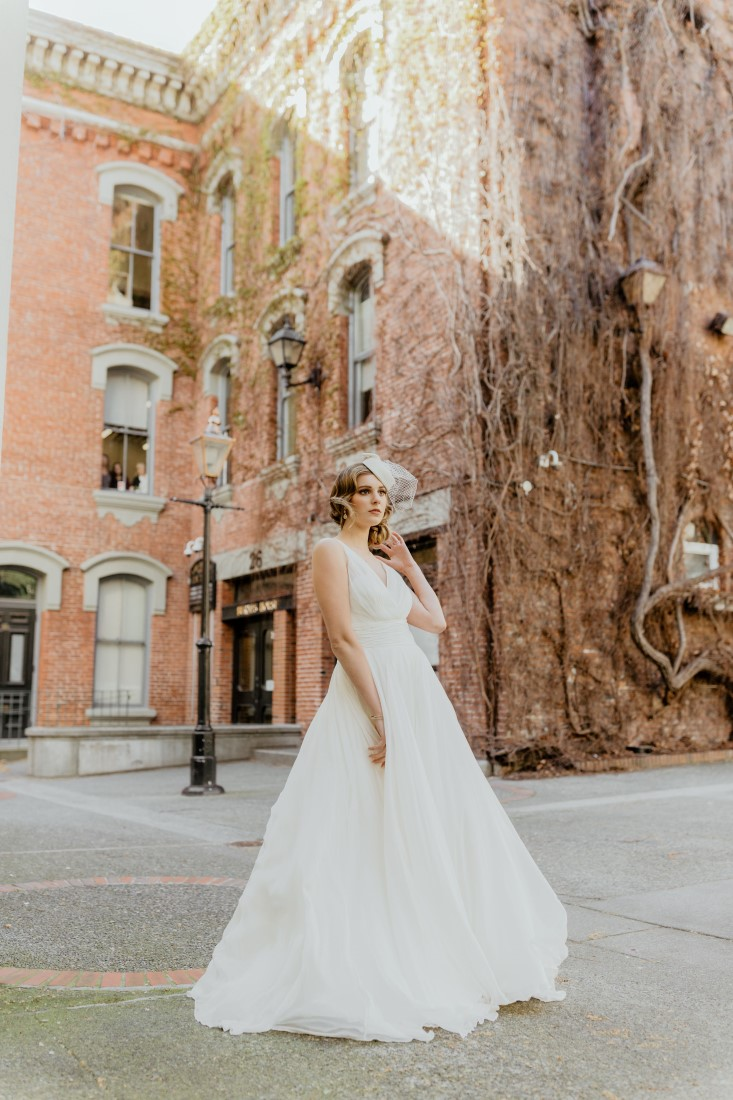 Coffee Love in Comox Valley Luke Liable Photography bride strikes a pose in gorgeous flowing gown