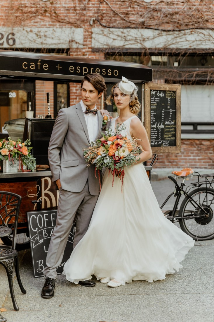 Coffee Love in Comox Valley Luke Liable Photography bridal couple in front of cafe coffee bar