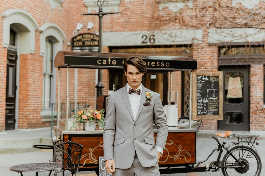 Coffee Love in Comox Valley Luke Liable Photography groom in grey suit, boutonniere and floral bowtie