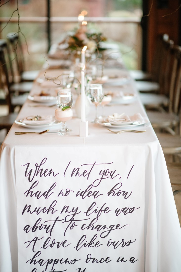Calligraphy on receptable table linens with white decor at Dolphin's Resort