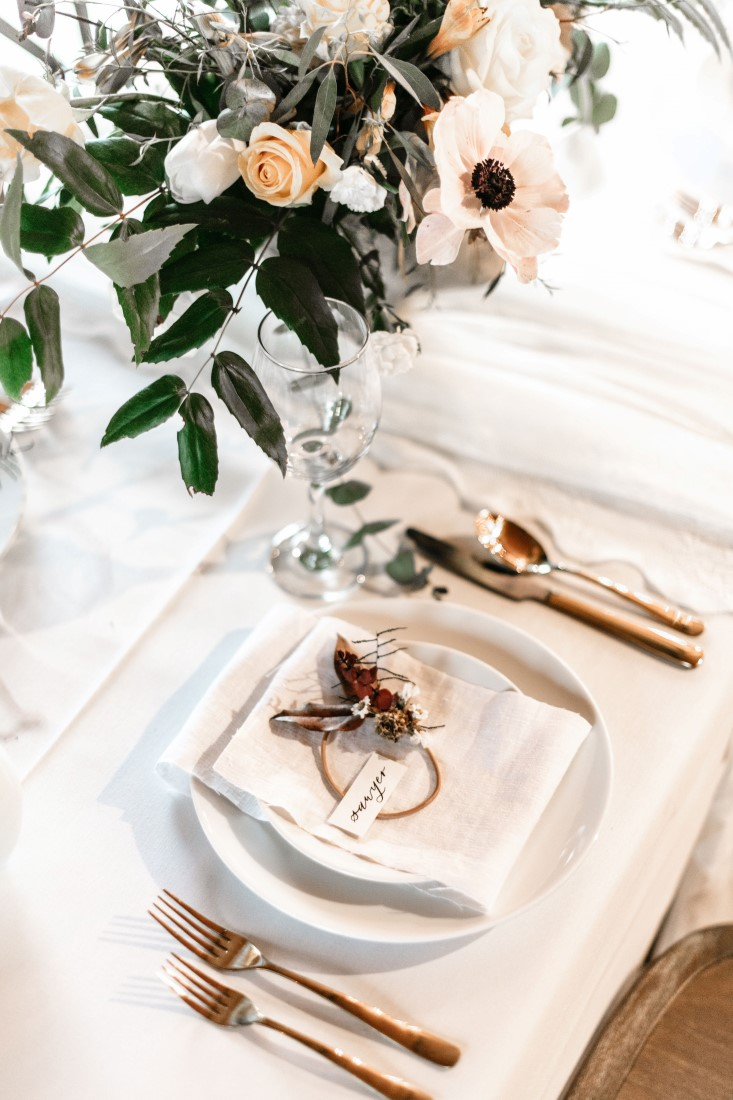 White on White reception table decor with gold cutlery