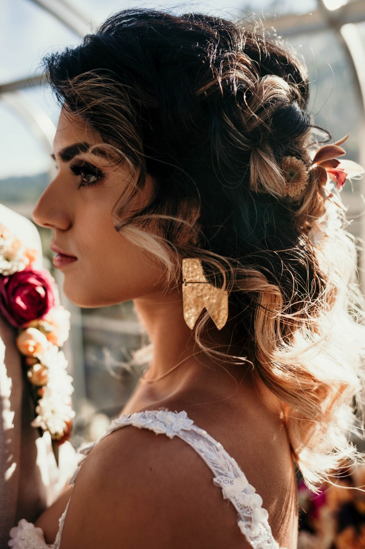 Bride with up do and flowers by Kendra Epp