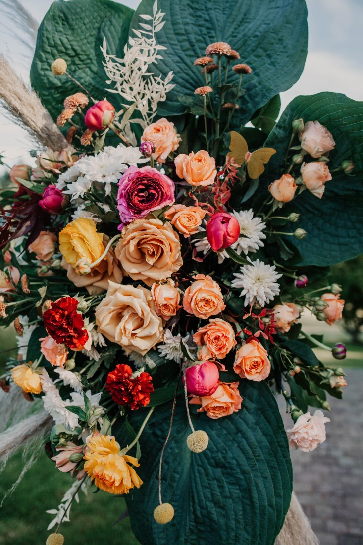 Cascade of roses on wedding reception table by Brown's the Florist Vancouver Island