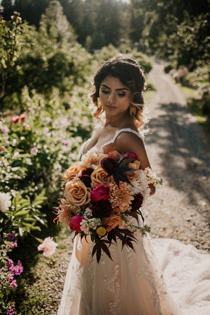 Bride holds lush bouquet of antique roses by Brown's the Florist Vancouver Island