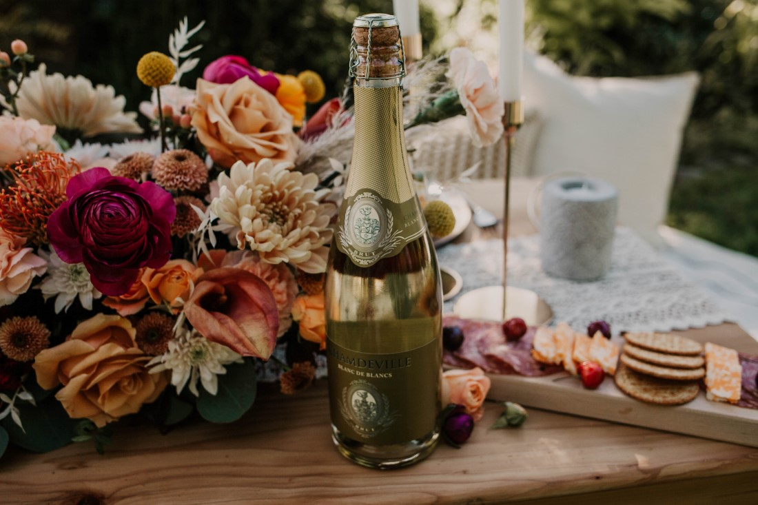 A Styled Elopement picnic and sweetheart table covered with antique roses