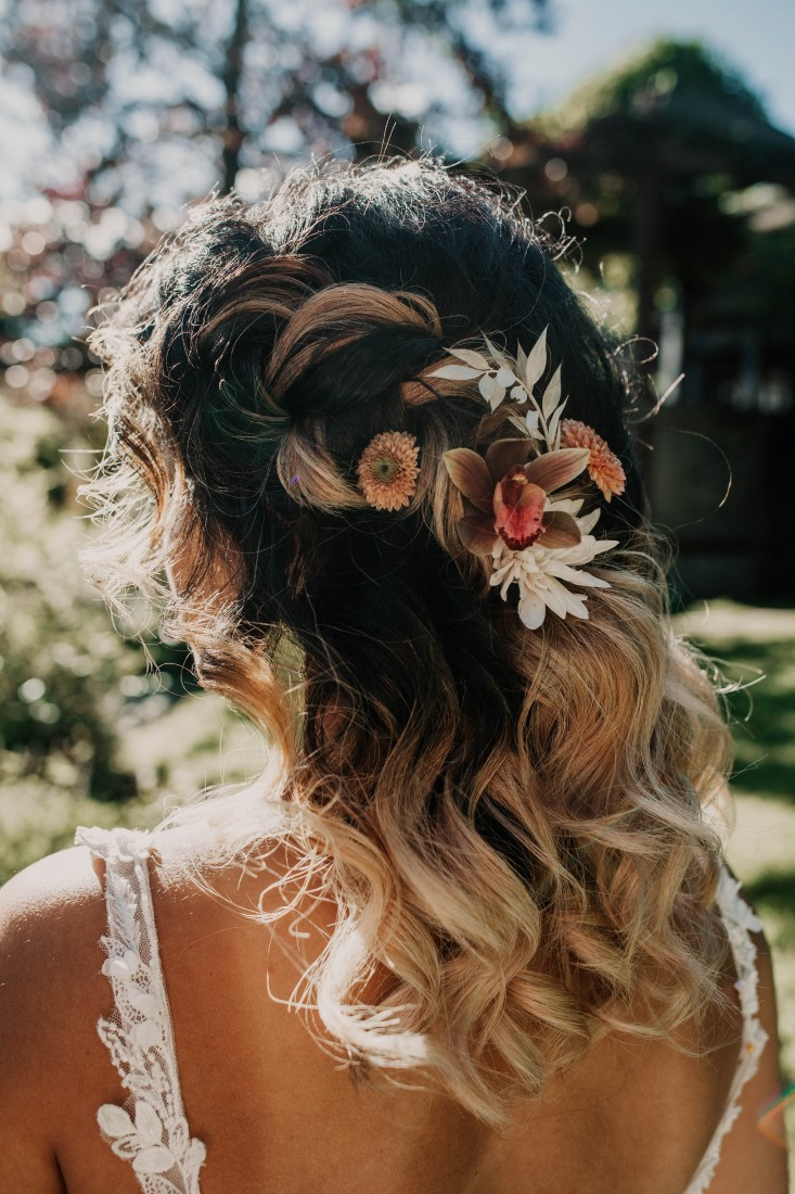 Flowers in bride's hair by Kendra Epp Vancouver Islnad