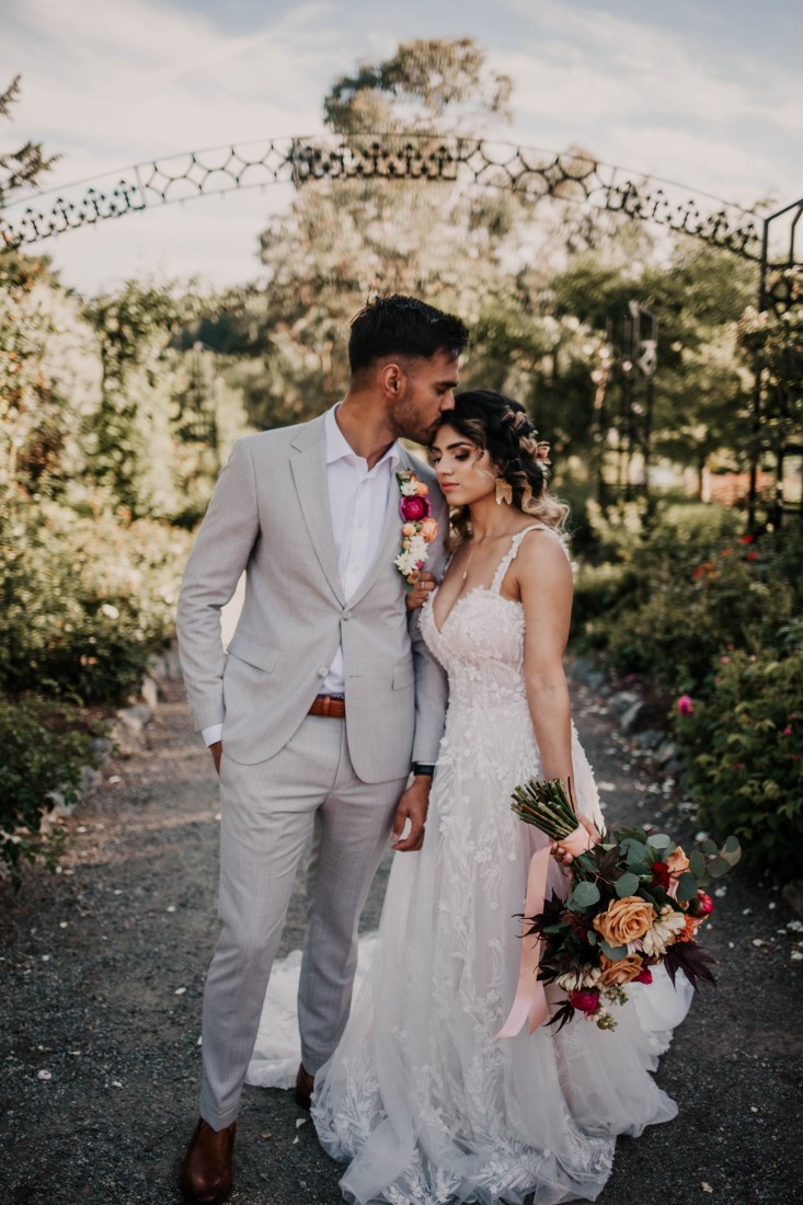 A Styled Elopement at HCP Gardens newlyweds walk down path