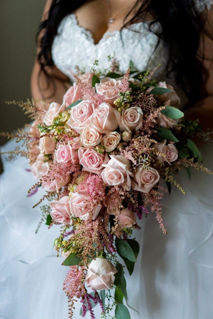 Stunning cascading bridal bouquet of pink roses by Niki Trading Vancouver