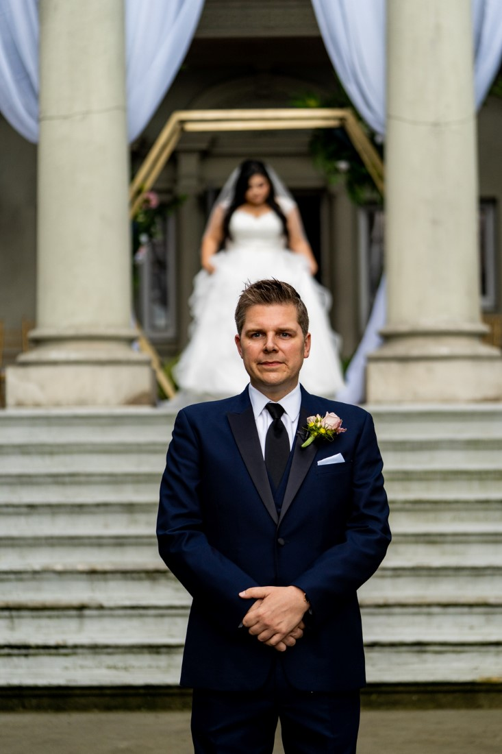 First Look for bride and groom on the stairs of Hycroft Manor in Vancouver