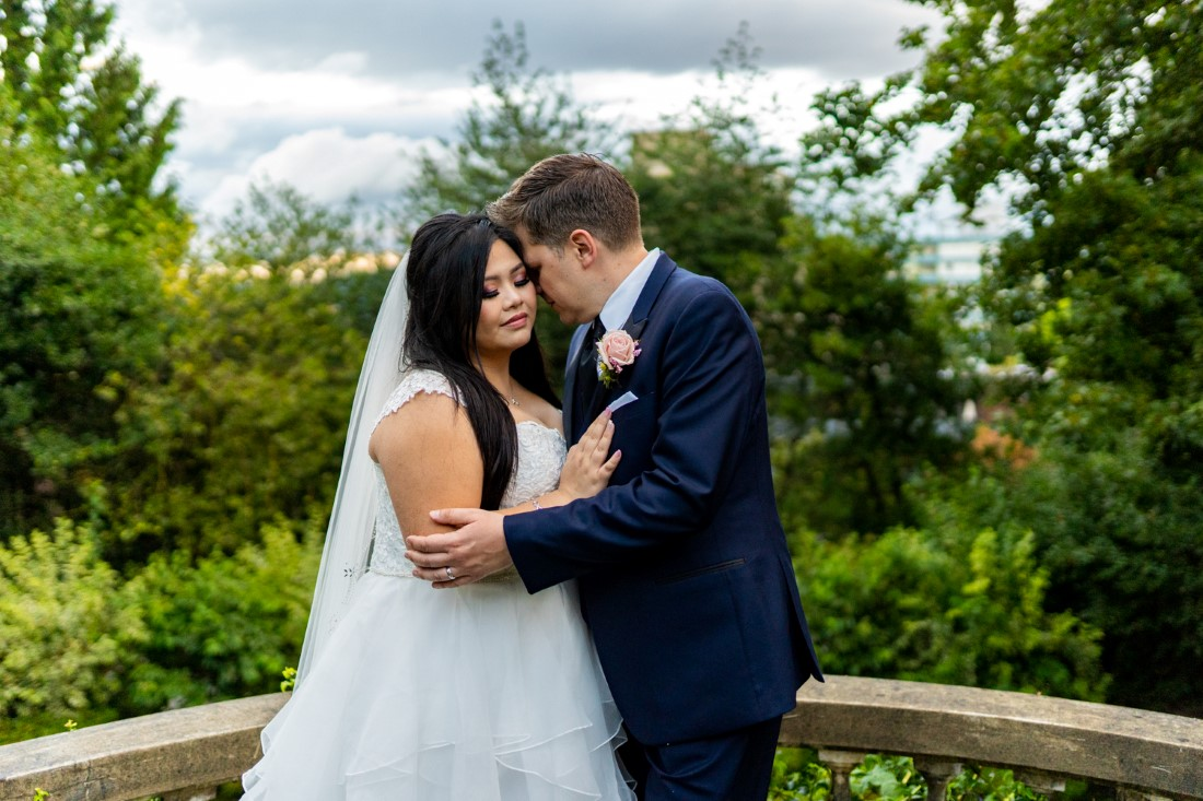 Bride and Groom embrace in the Gardens of Hycroft Manor