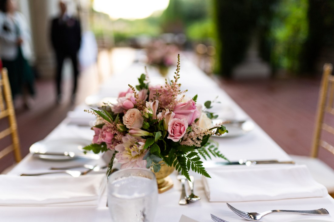 Blush and pink roses on wedding reception table by Niki Trading Vancouver