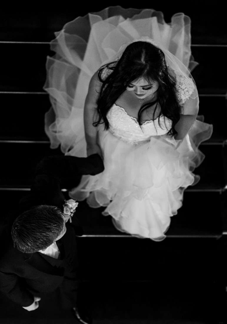 Bride comes up the stairs in black and white by Justin Kho Photography Vancouver