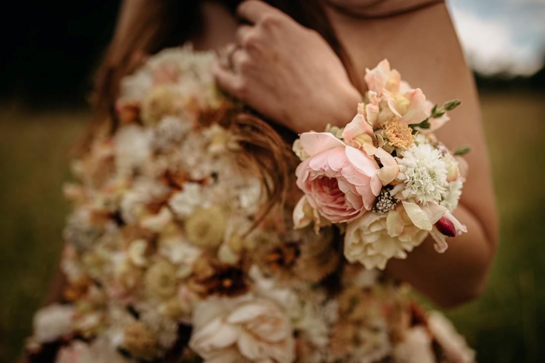 Bride wears flowers on entire body by Karen Bezaire