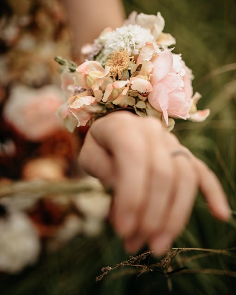 Bride wears flower bracelets and anklets