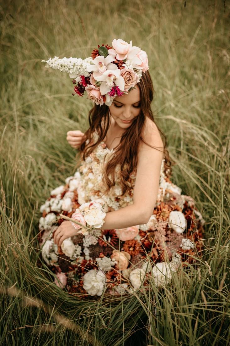 Bride wears flowers and head wreath by Karen Bezaire