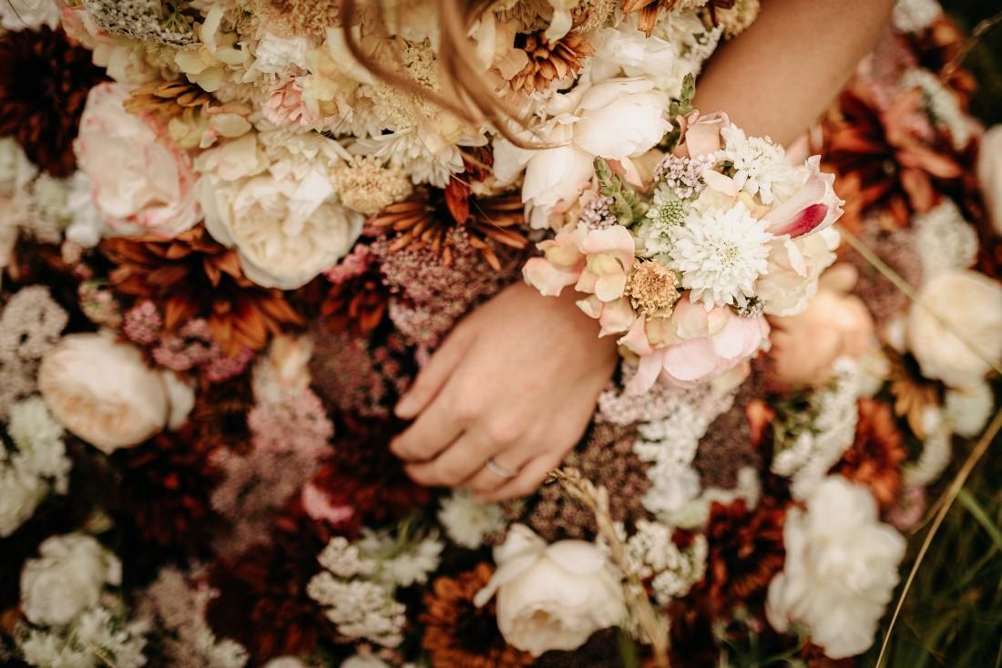 Flower bracelets on bride