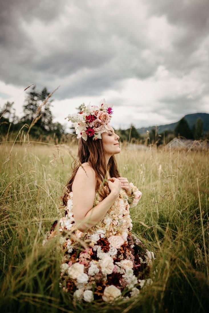 Bride dressed in flowers in Vancouver Island meadow