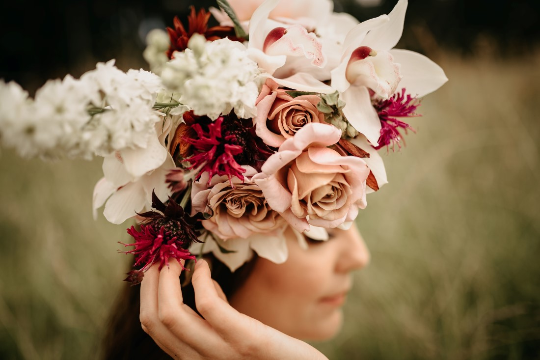 Bridal wreath of roses and orchids by Ingrid Rose Artistry
