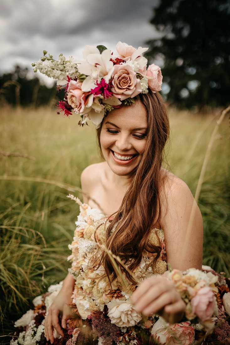 Flirty Floral Gown bride with head wreath of roses and orchids