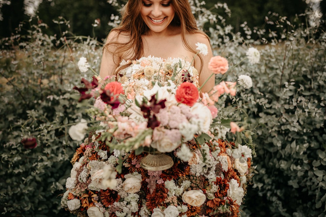 Dandelion Farm bride holds lush wedding bouquet
