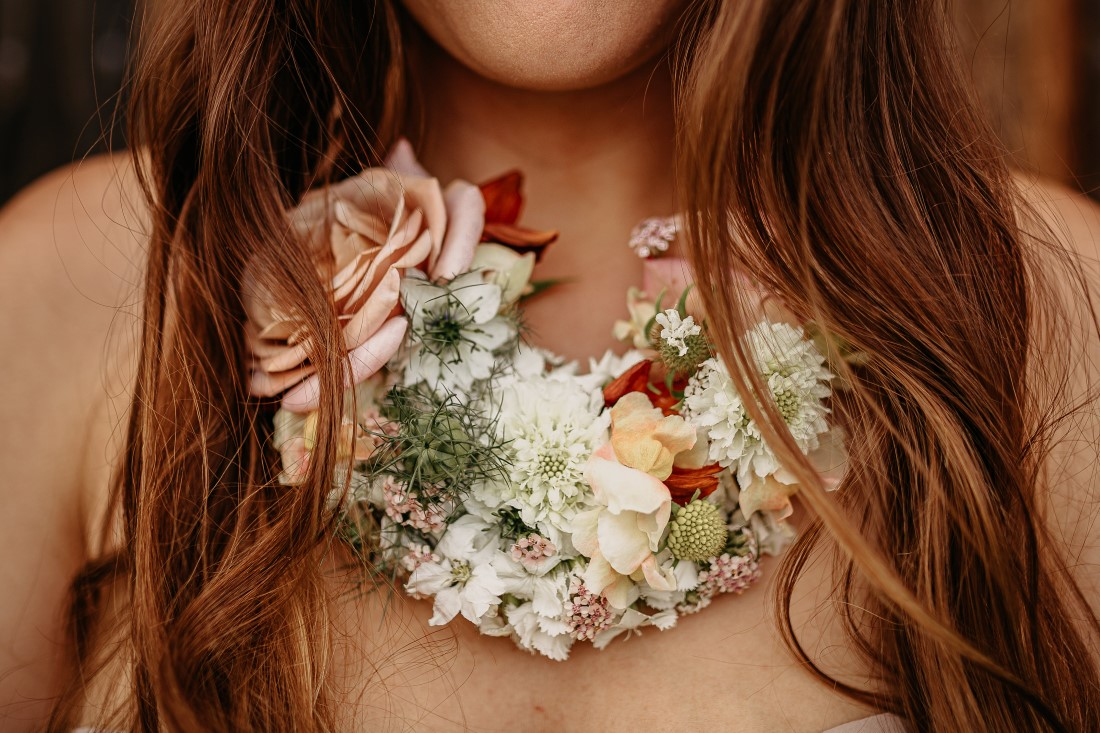 Floral necklace of orchids and roses by Karen Bezaire
