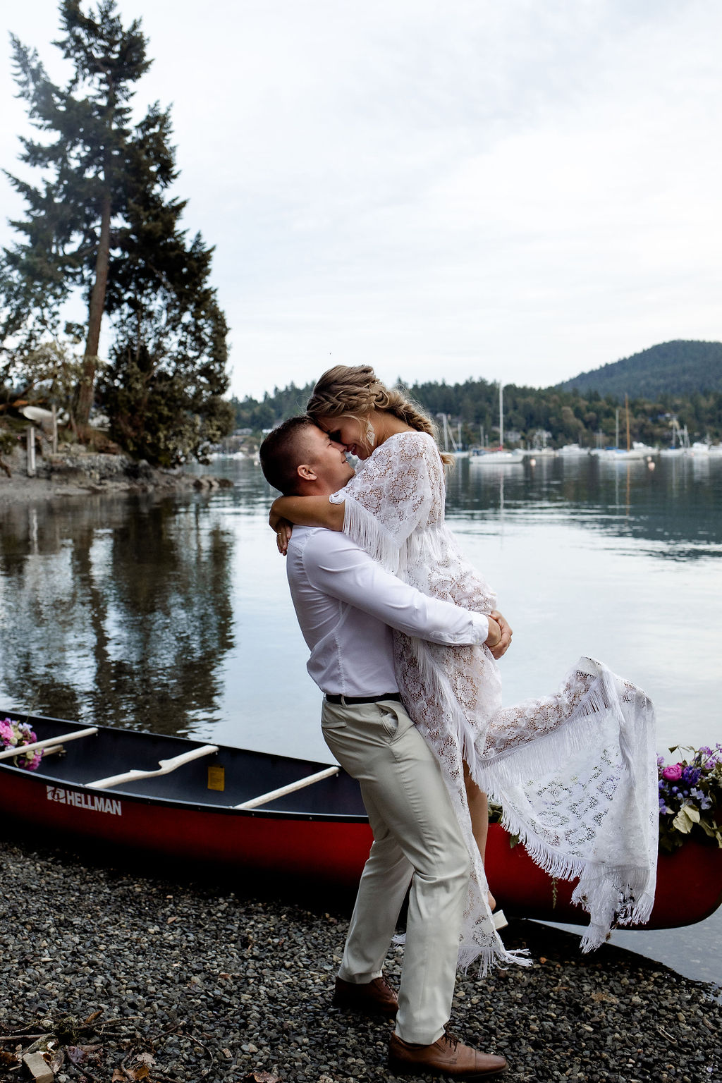 Groom lifts his bride out of a canoe