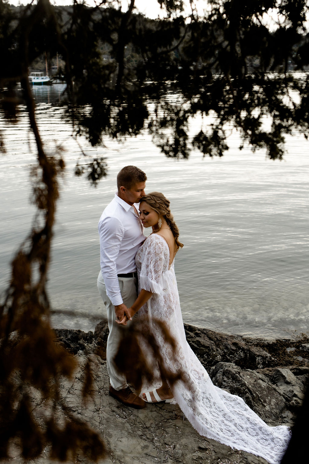 Adventure Elopement Couple pose in front of the ocean on Vancouver Island
