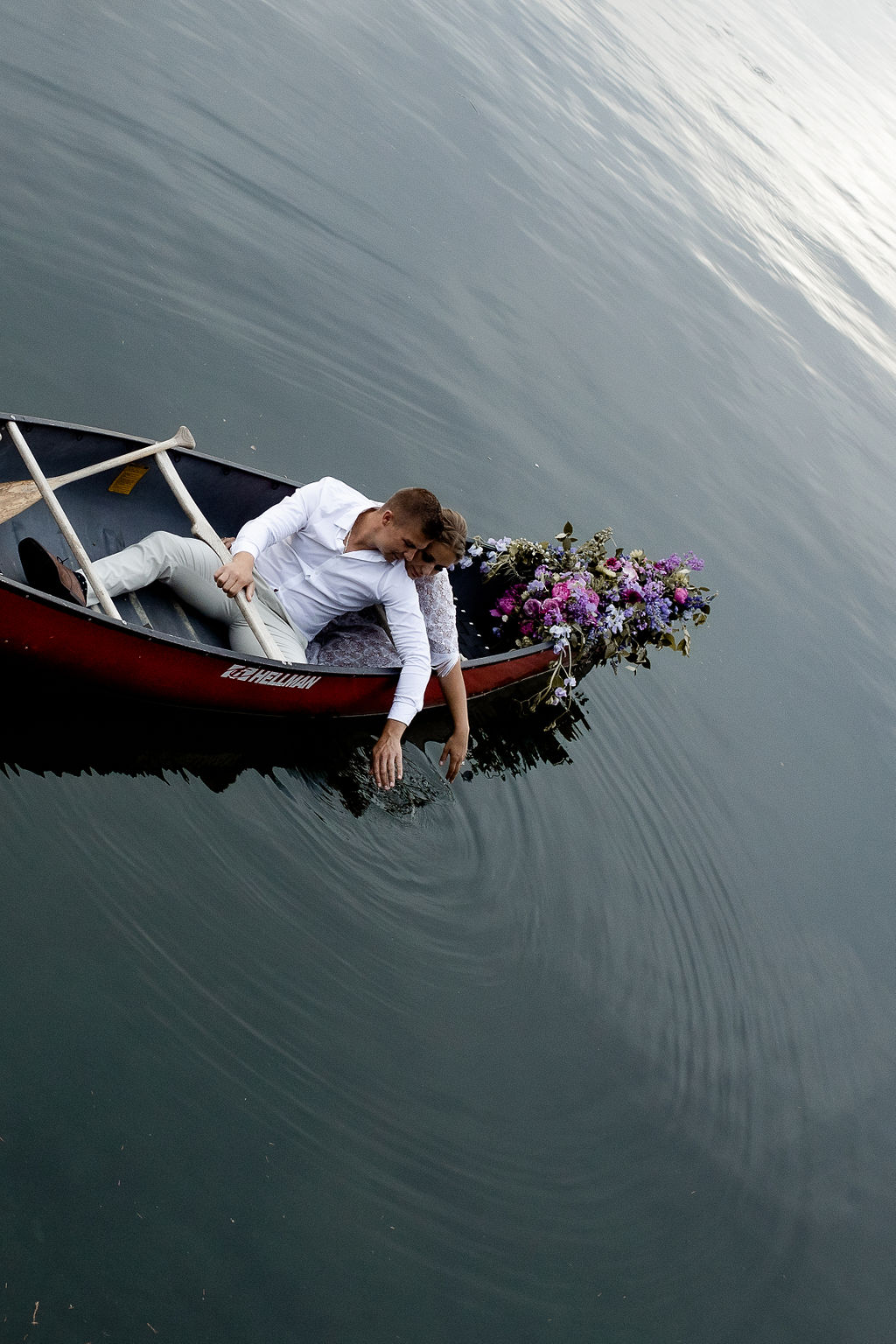 Adventure Elopement Groom in a canoe on Vancouver Island