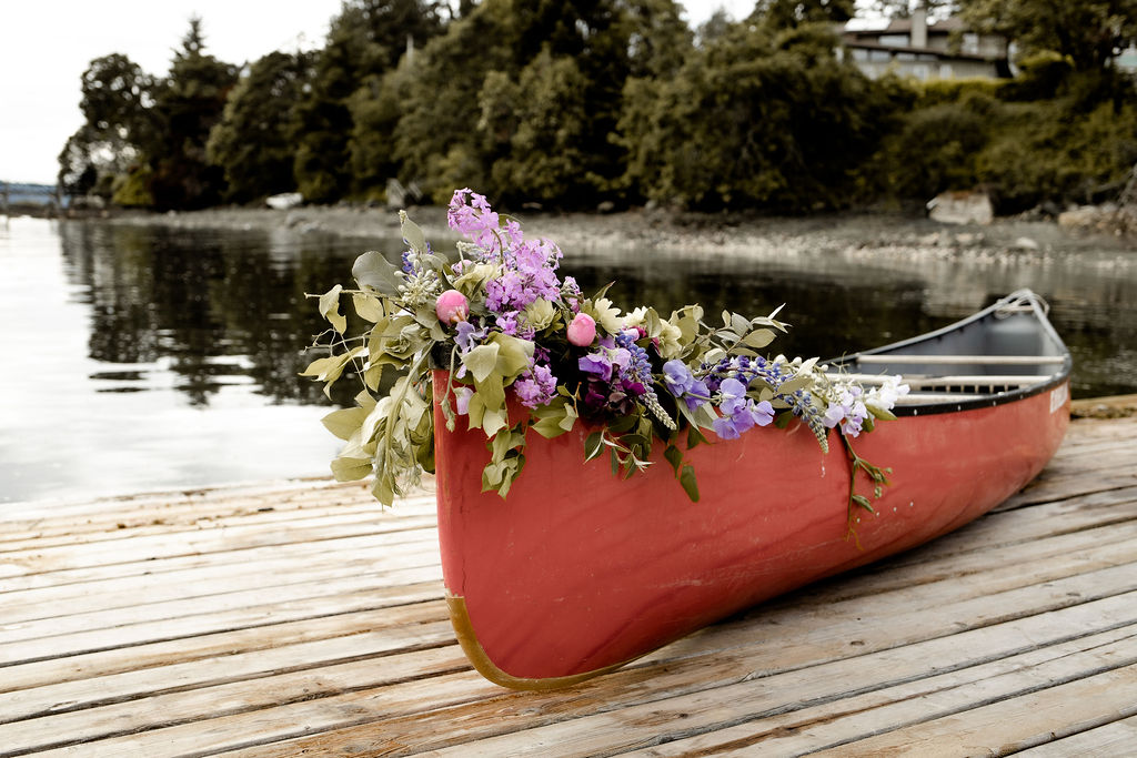 Flowers on the front of a canoe by Little Bee Blooms Vancouver Island