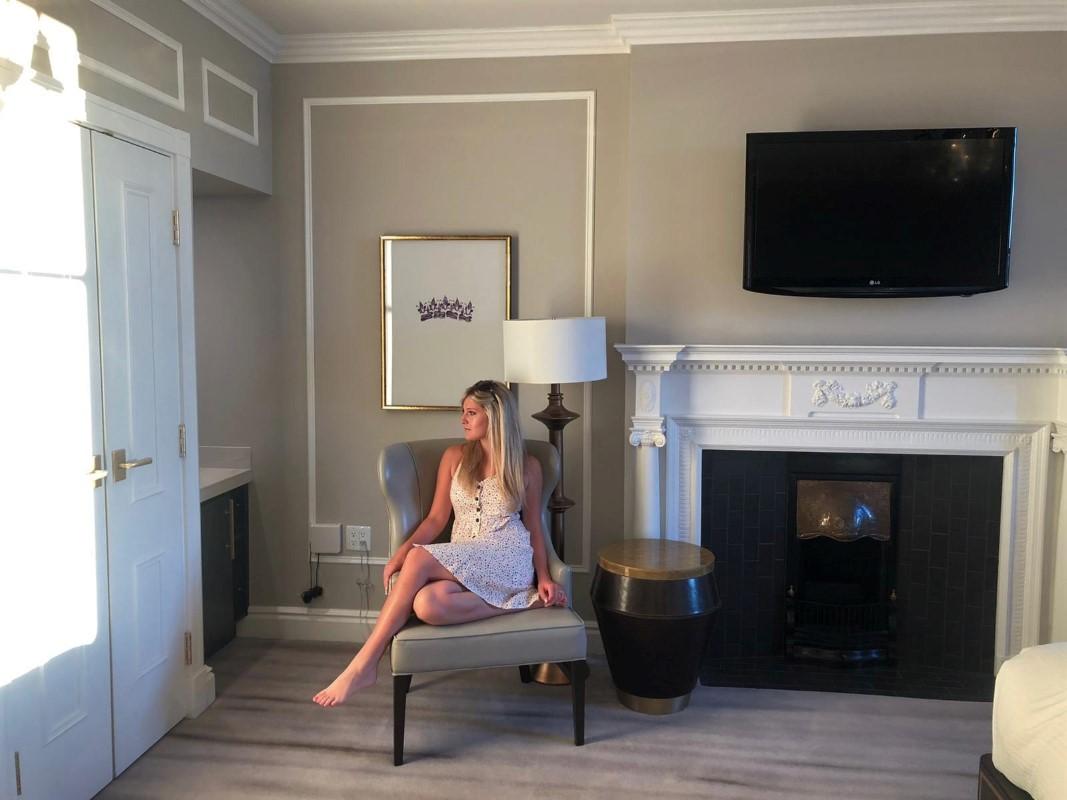 Bride sits in Fairmont Empress Junior Suite on honeymoon on Vancouver Island