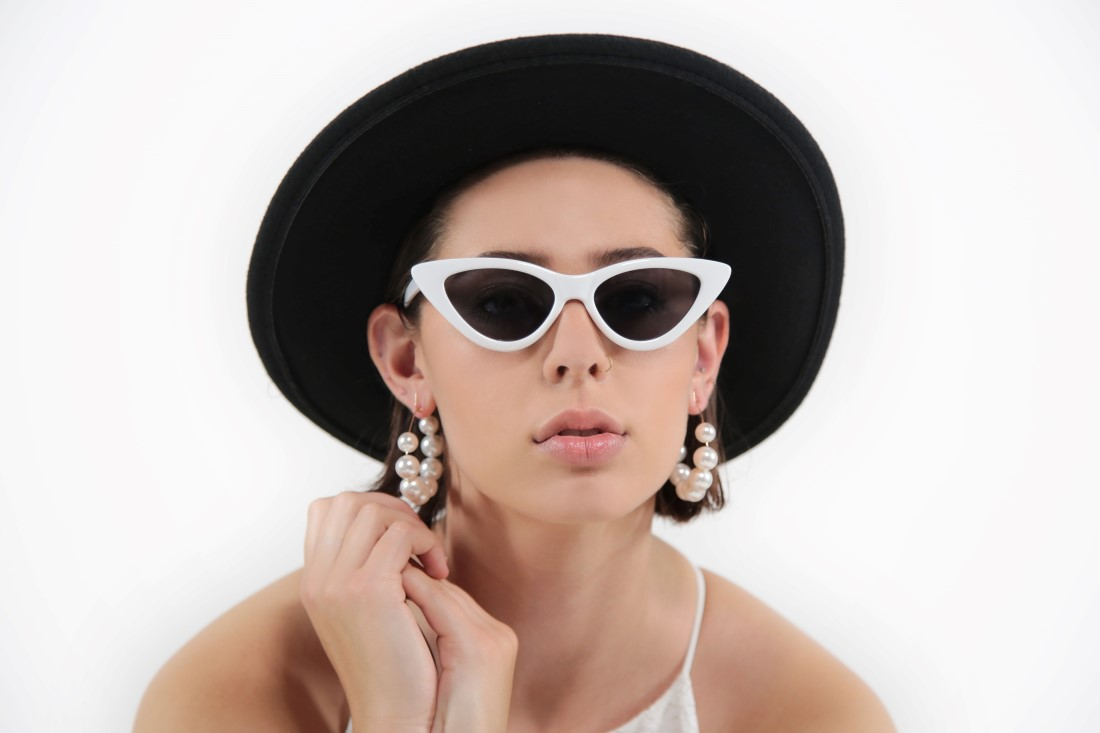 Vancouver Bride wearing Simone Martin Atalier and black round hat with white sunglasses