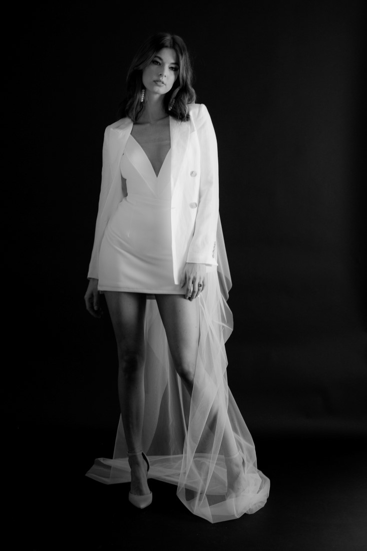 Bride in long veil and white suit jacket by Fern and Moon Vancouver